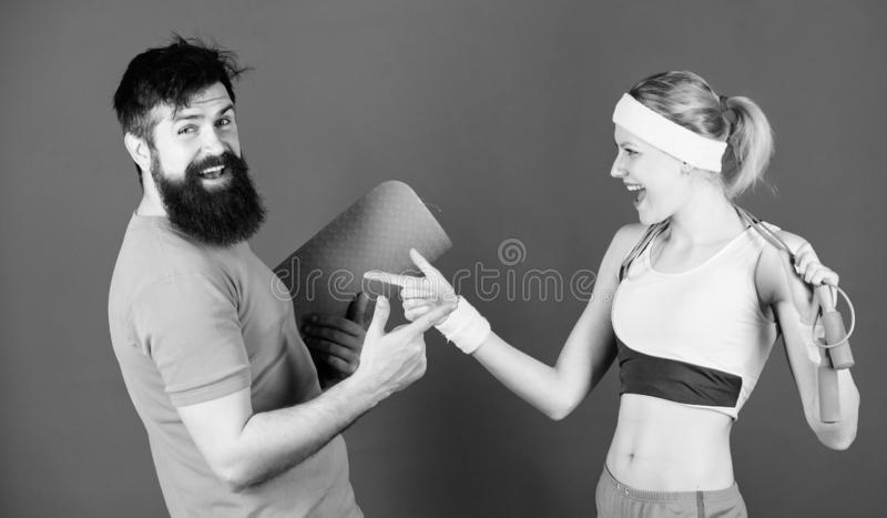 Together Everyone Achieves More. Athletic Success. Sport equipment. Strong muscles and body. Happy woman and bearded man royalty free stock photo