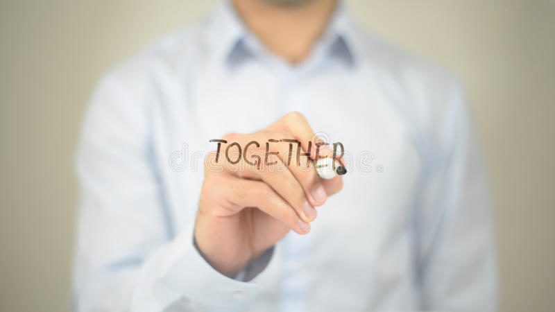 Together, Man Writing on Transparent Screen. High quality royalty free stock photos