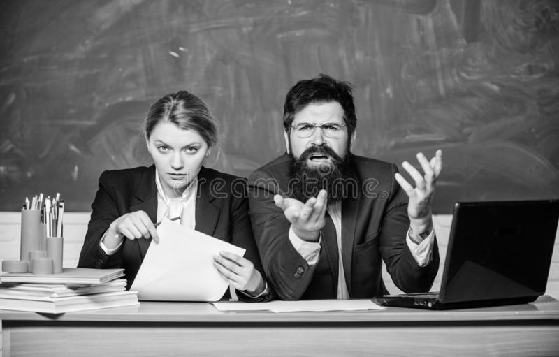Together since school. paper work. office life. back to school. formal education. business couple use laptop and. Document. teacher and student on exam stock photo