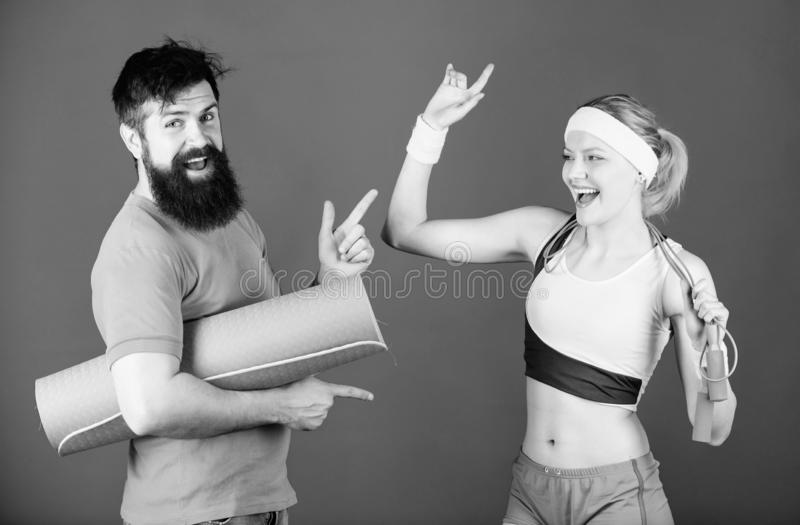 Together Stronger. Sport equipment. Sporty couple training with fitness mat and skipping rope. Happy woman bearded man. Together Stronger. Sport equipment stock photos