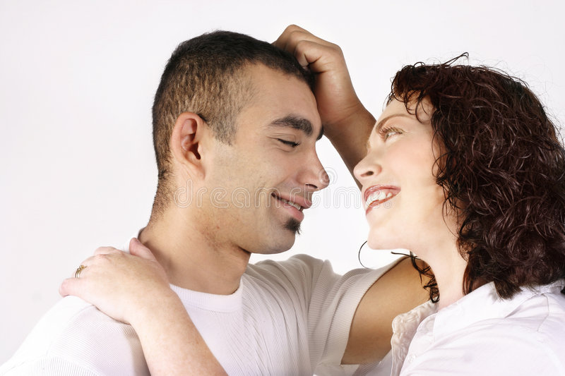 Togetherness. Diverse couple share a beautiful moment together. Woman's face is soft focus royalty free stock images