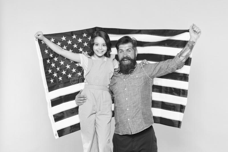 The togetherness of a family. Happy family celebrating independence day. Patriotic family of father and little daughter royalty free stock photos