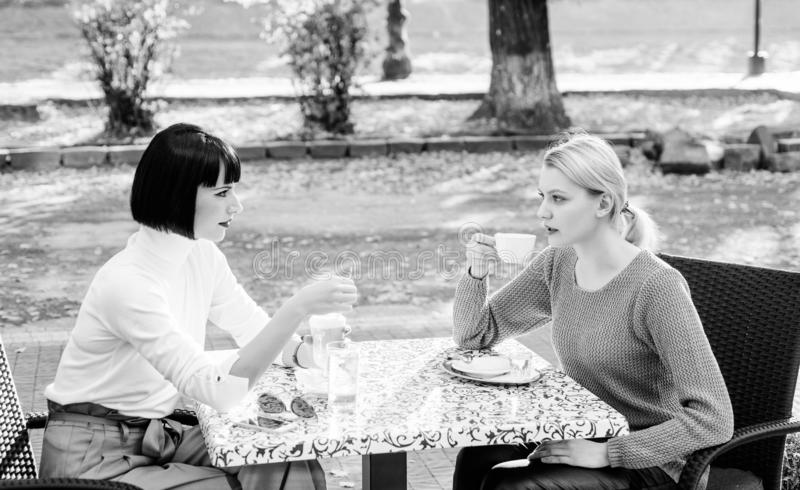 Togetherness and female friendship. True friendship friendly close relations. Trust her. Female friends sit in coffee stock image
