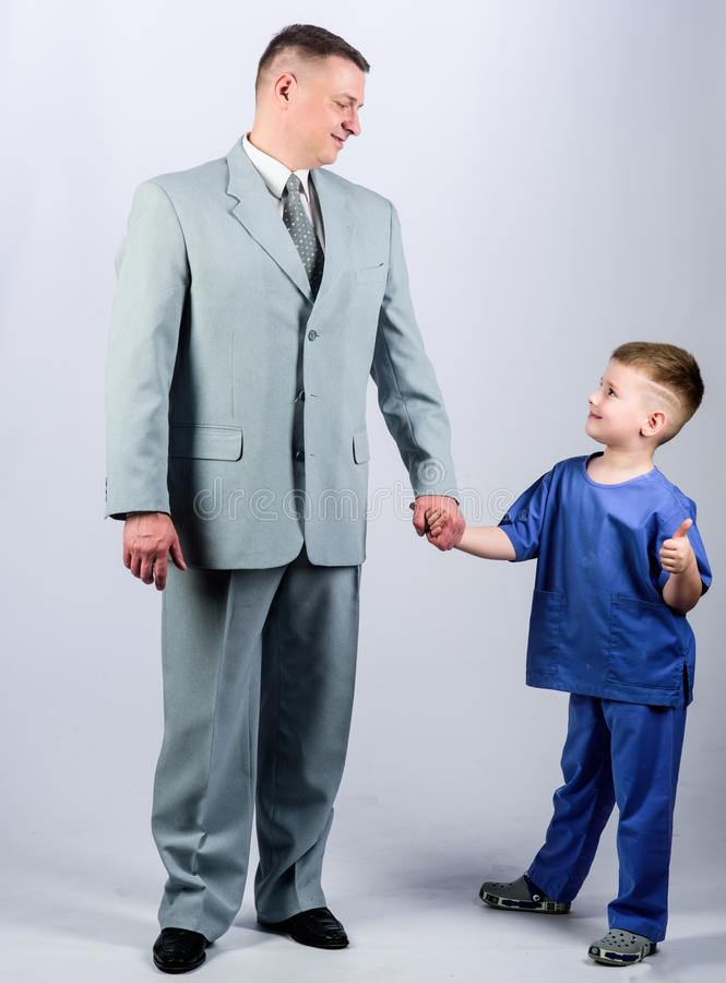 Togetherness. trust and values. fathers day. family day. father and son in business suit. male fashion. happy child with. Father. business partner. small boy royalty free stock photo
