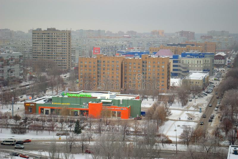 Winter panorama of the city overlooking Voroshilov Street and the renovated building of the former Youth Palace. Togliatti, Samara region, Russia - December 20 royalty free stock photos