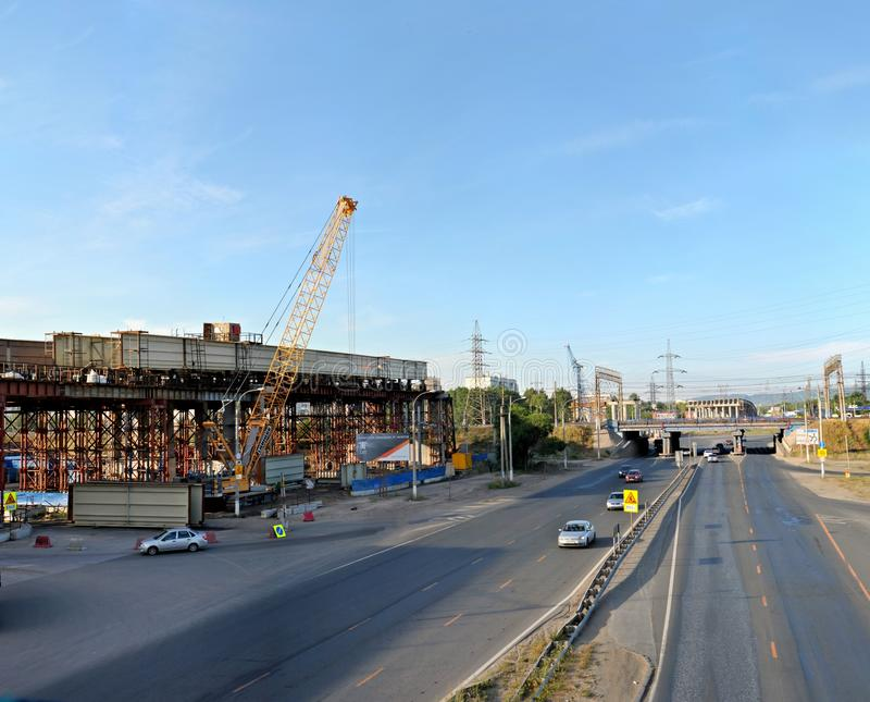 Togliatti, Samara region, Russia - July 01, 2019: Morning panoramic view of the road junction under construction. The photo is stitched from several frames royalty free stock photography