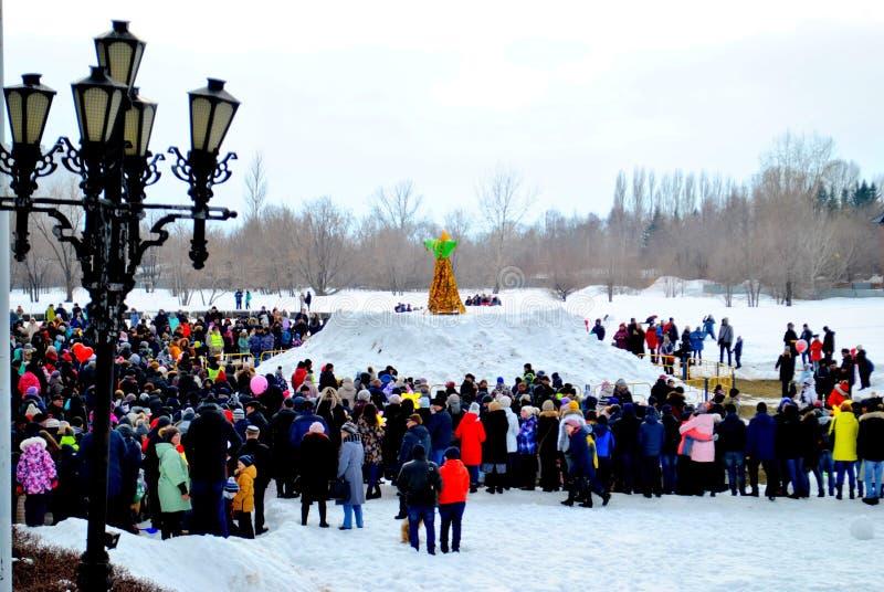 Celebration of Maslenitsa: people are waiting for the moment of burning stuffed Maslenitsa. Togliatti, Samara region, Russia - March 10, 2019: Celebration of royalty free stock photo