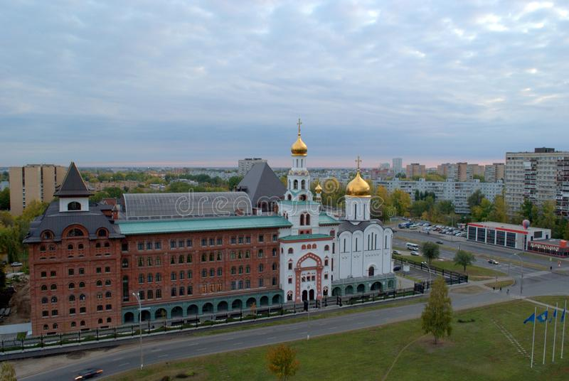 Panorama of the city on an early autumn morning with a view of the Volga Orthodox Institute and the Church of the Three Saints. royalty free stock photos