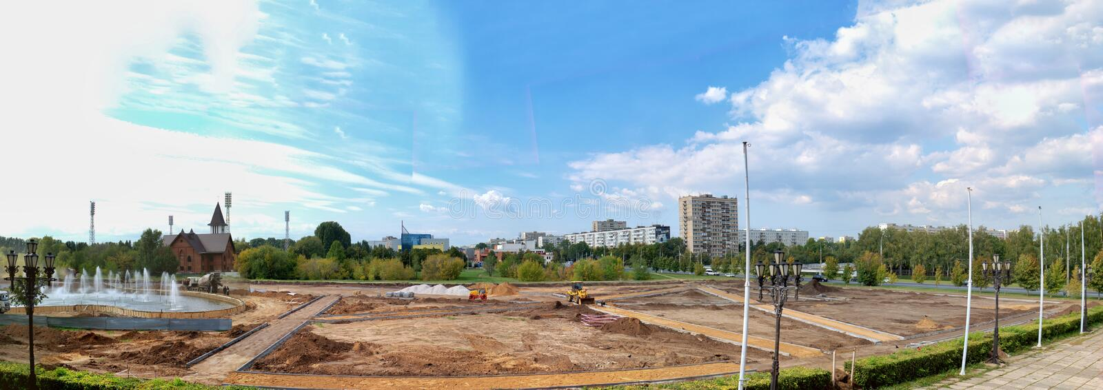 Repair of the fountain and the construction of a new square in the wasteland between the Catholic Church and the Sports Palace. royalty free stock photo