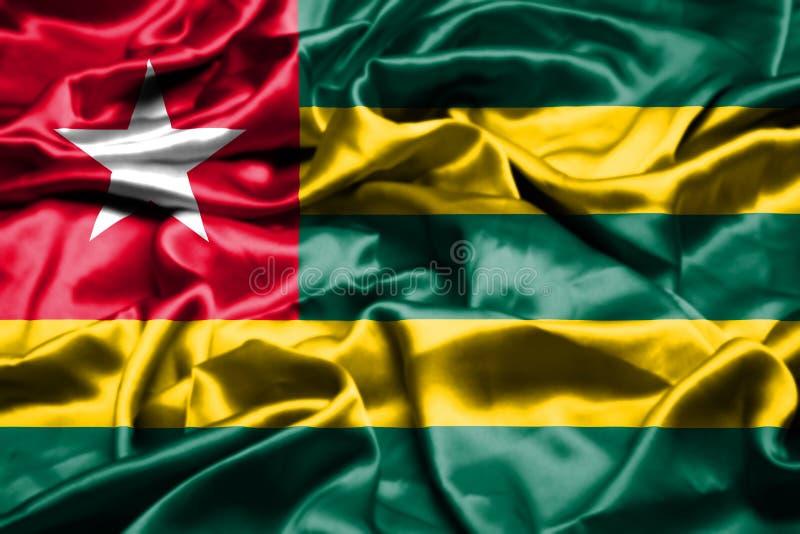 Togo flagga som vinkar i vinden vektor illustrationer