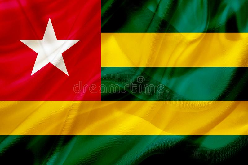 Togo landsflagga p? siden- eller silkeslen vinkande textur stock illustrationer