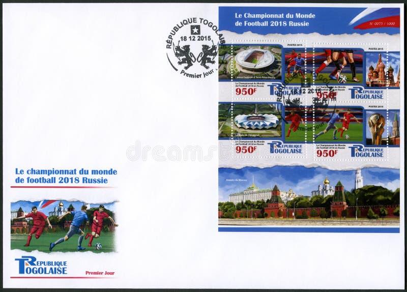 TOGO - 2015: visar fotbollsspelaren och stadion, fotbollvärldscupen 2018 Ryssland fotografering för bildbyråer