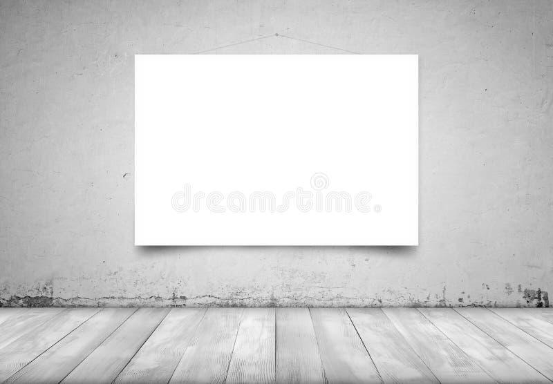Toile blanche carrée accrochant sur le mur en béton dans l'intérieur photographie stock