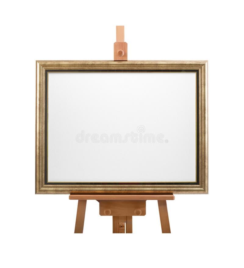 toile blanche de peintre dans le cadre sur le chevalet en bois d 39 isolement sur le blanc photo. Black Bedroom Furniture Sets. Home Design Ideas