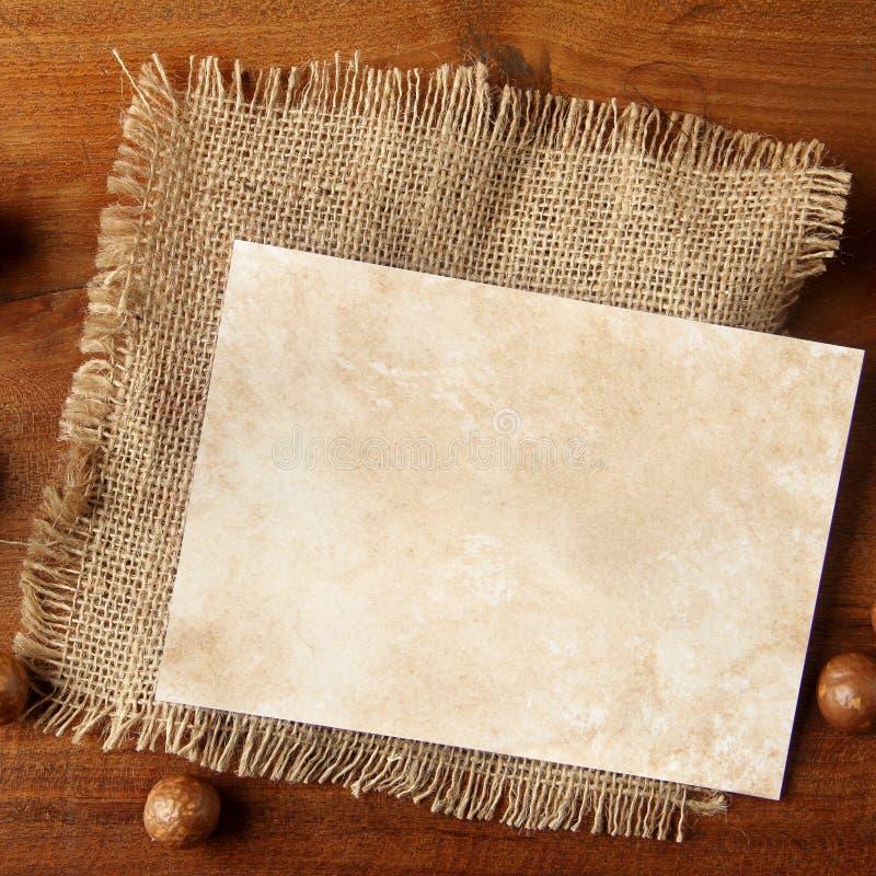 Toile de jute de papier sur le panneau de teakwood photographie stock
