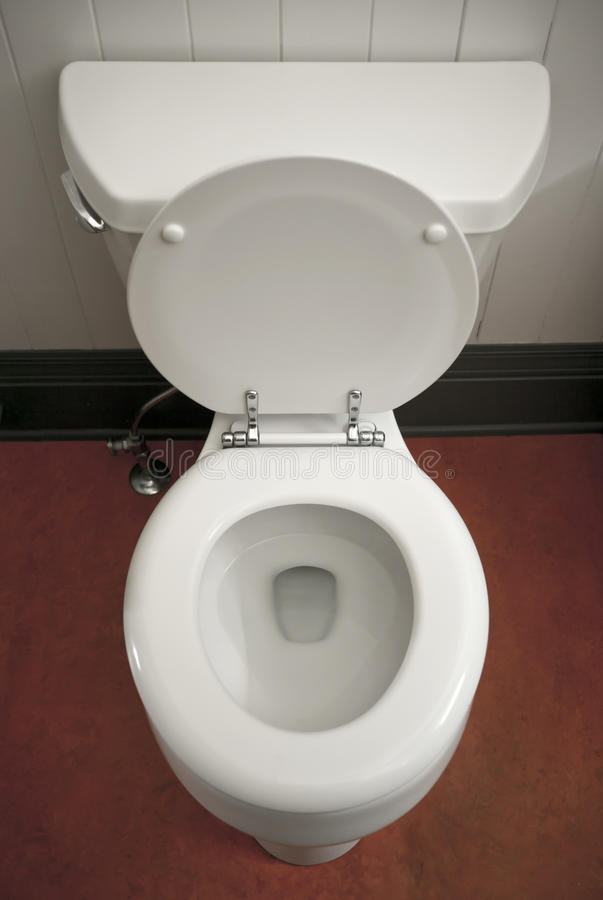 Toilet. A white porcelain toilet with the lid up, seat down stock photo