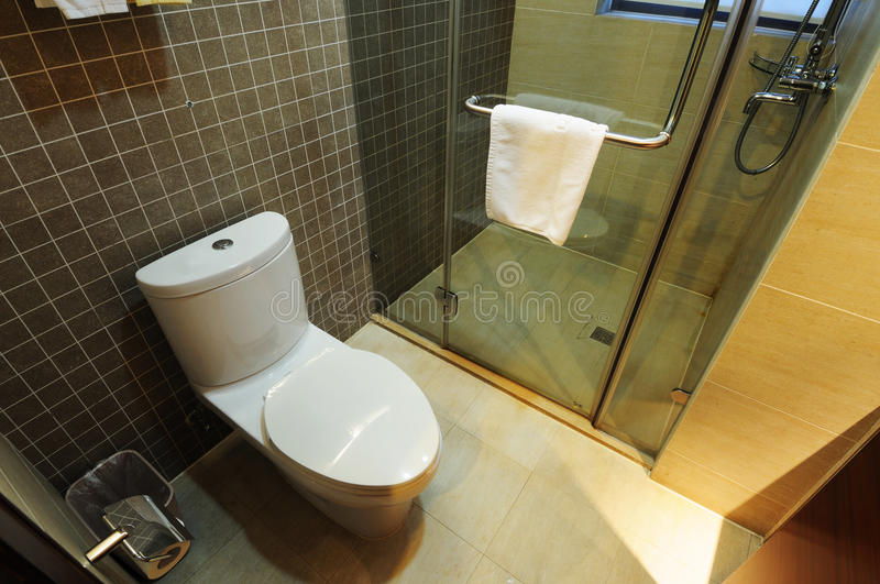 Toilet. A view of a toilet in a hotel room stock photography