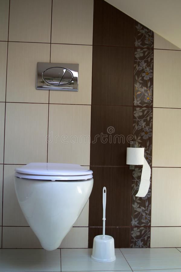 Modern toilet in brown and creamy royalty free stock image