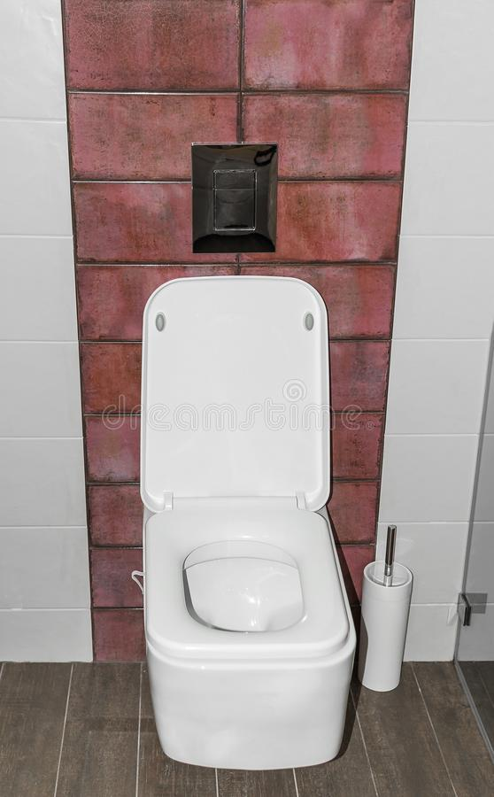 Toilet in the bathroom. Toilet in the bathroom on the background of tiles. Close-up stock photo