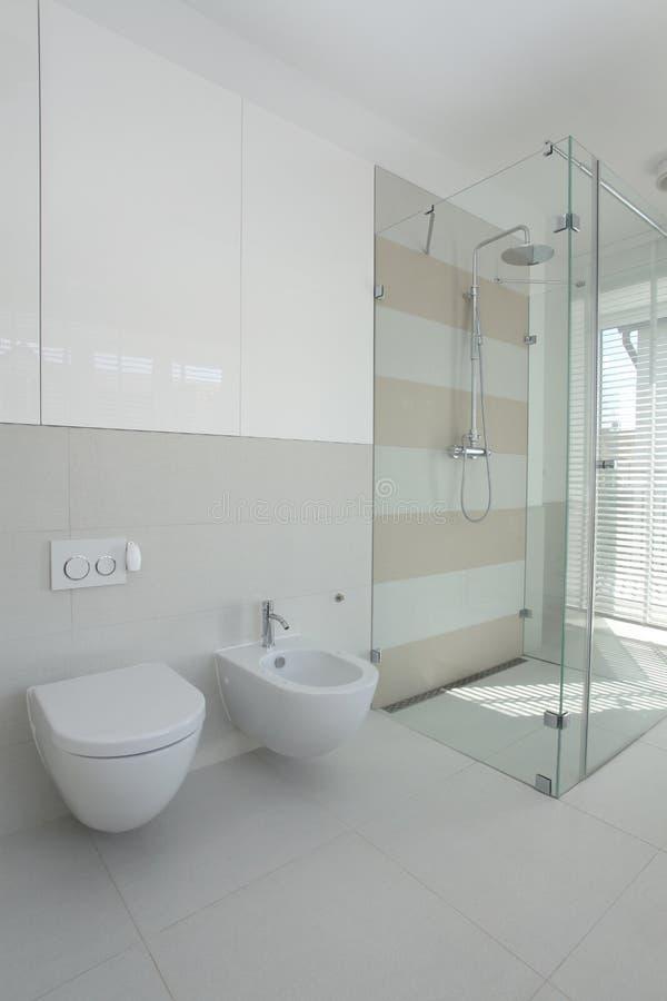 Toilet, bidet, shower stock photography