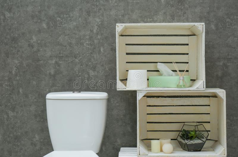 Toilet bowl and decor elements near grey wall. Bathroom interior royalty free stock photos