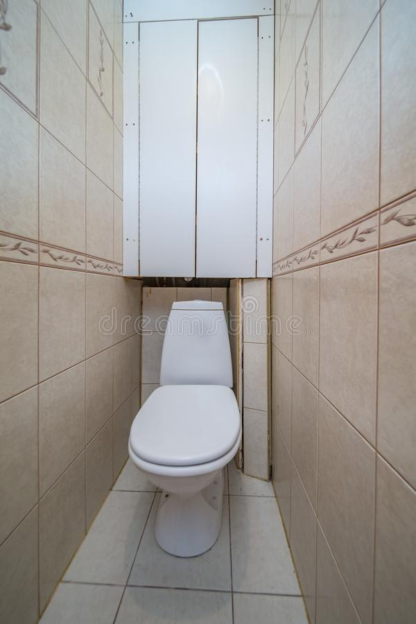 Restroom with toilet. Toilet bowl in the toilet room. Restroom with brown tile decoration stock photo