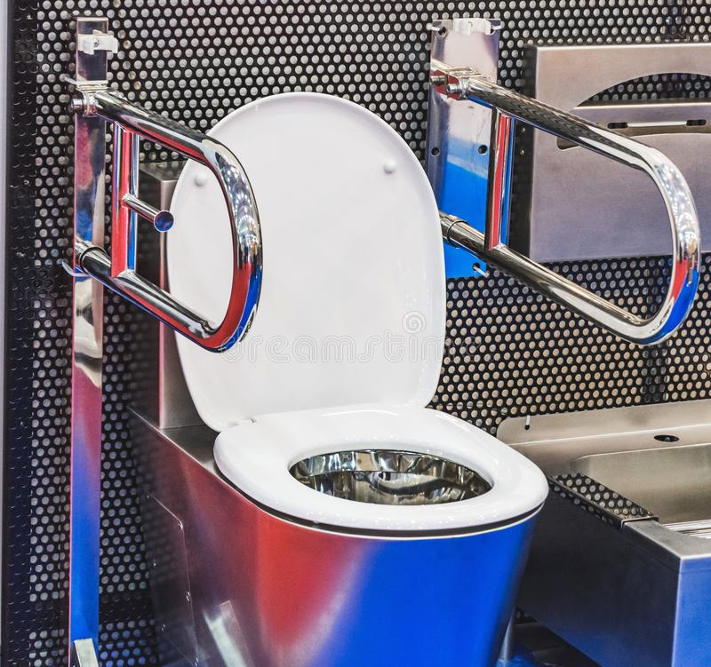 Toilet for disabled people with metal handrails for installation in vehicles, trains, buses and other.  royalty free stock photo