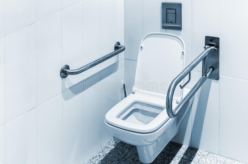 Toilet With Handrails For The Disabled Stock Image - Image: 52627807