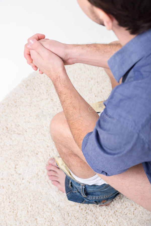 Toilet. Man is sitting on the toilet. View from above royalty free stock photo
