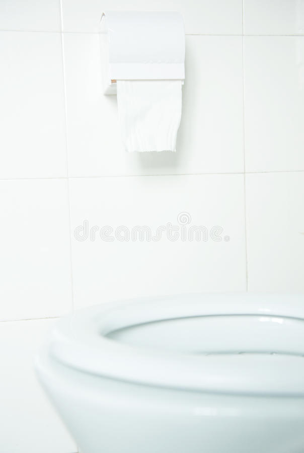 Toilet paper. Hanging on the wall stock photography