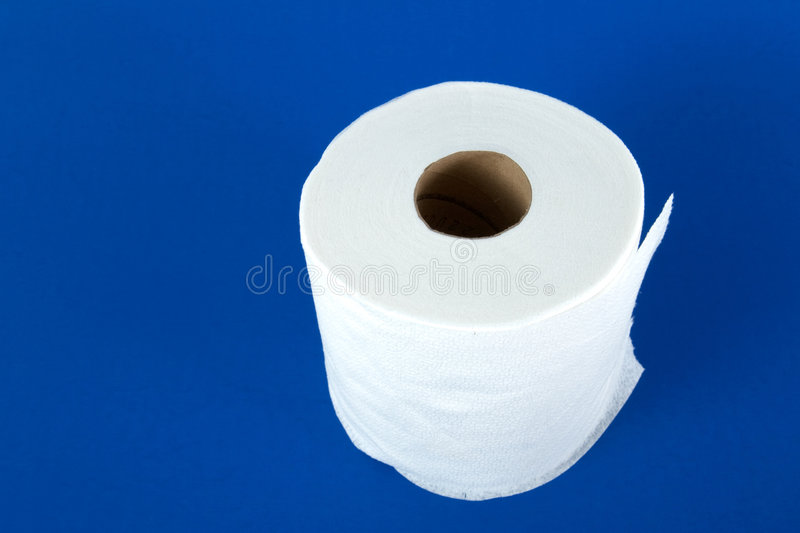 Toilet paper. Roll of toilet paper on blue background stock photo