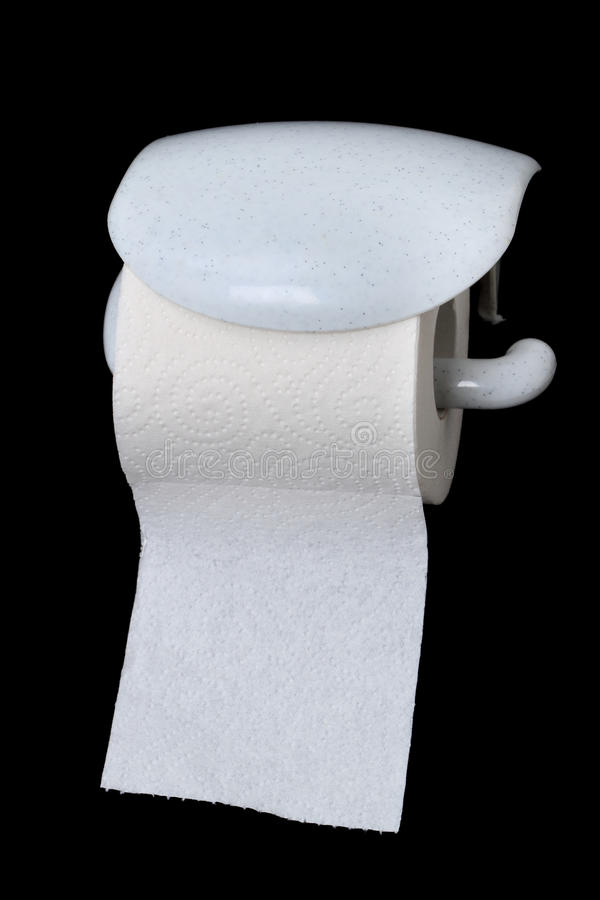 Toilet paper. One roll of toilet paper isolated on a black background stock image