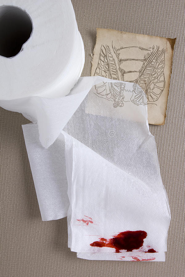 Toilet paper in the blood. Is associated with anal bleeding royalty free stock photos
