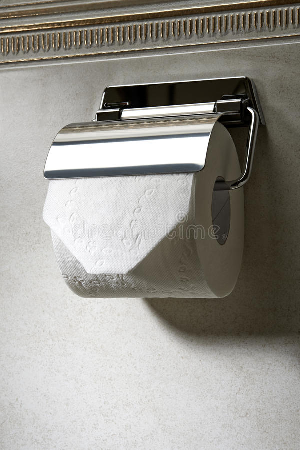 Toilet paper. Toilet-paper and holder on the tail wall royalty free stock photos