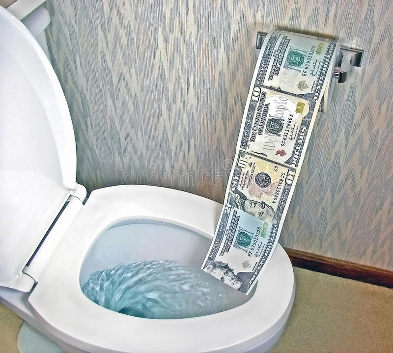 Toilet paper money in white toilet royalty free stock photo