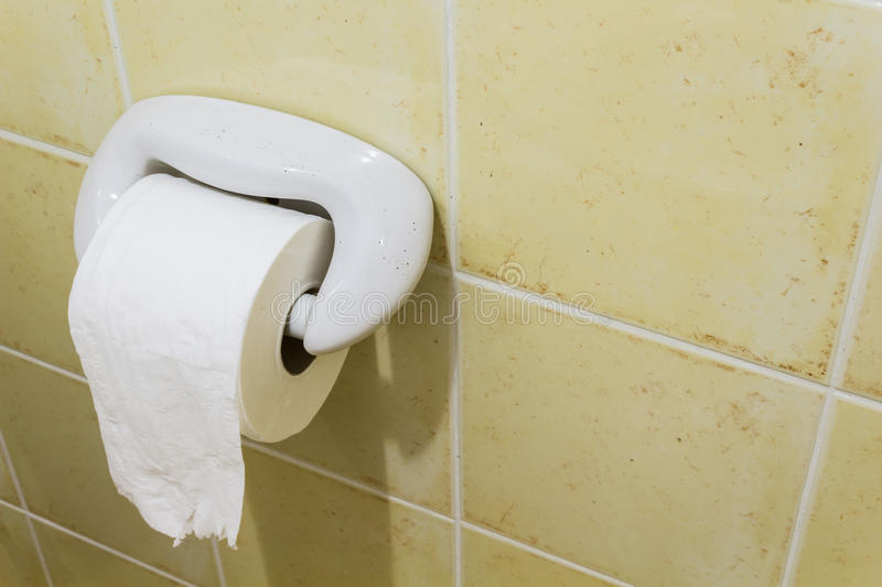 Toilet paper. A roll of toilet paper on holder royalty free stock images