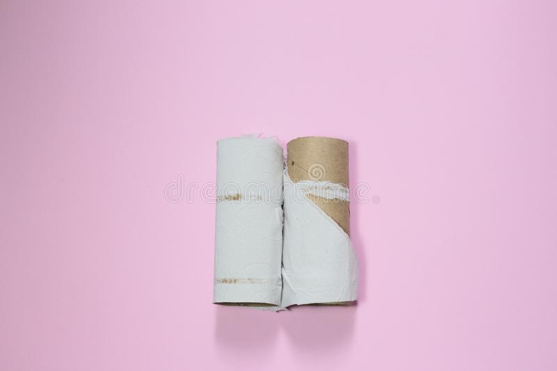 Toilet paper roll ran out. It`s a metaphor about couples, business, half feelings and emptiness stock photos