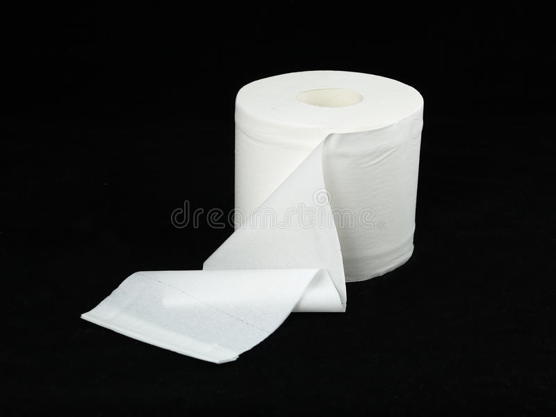 Toilet paper roll. One roll of soft toilet paper - isolated, neutral background royalty free stock photo