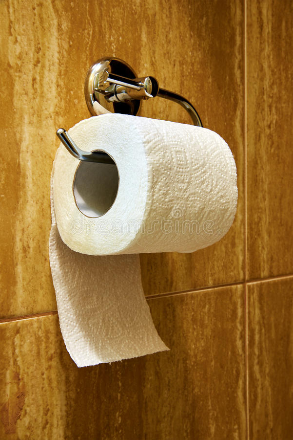 Toilet paper roll. On the wall in restroom royalty free stock image