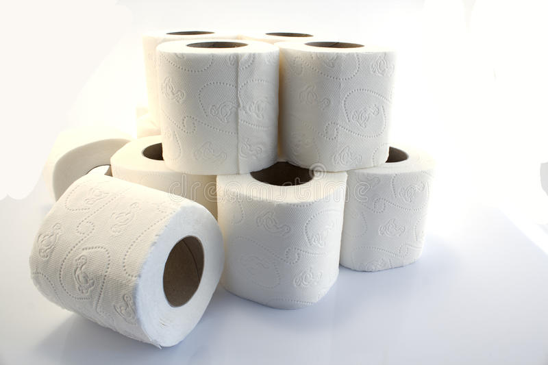 Toilet paper rolls on white stock photography