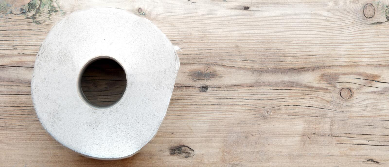 Toilet paper. On wood background stock images