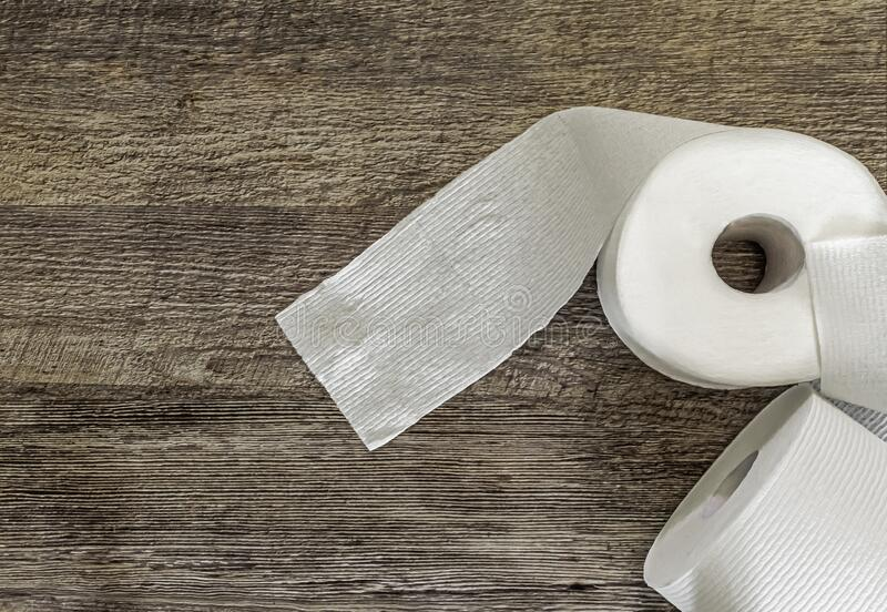 Toilet Paper on Wooden Backround royalty free stock images
