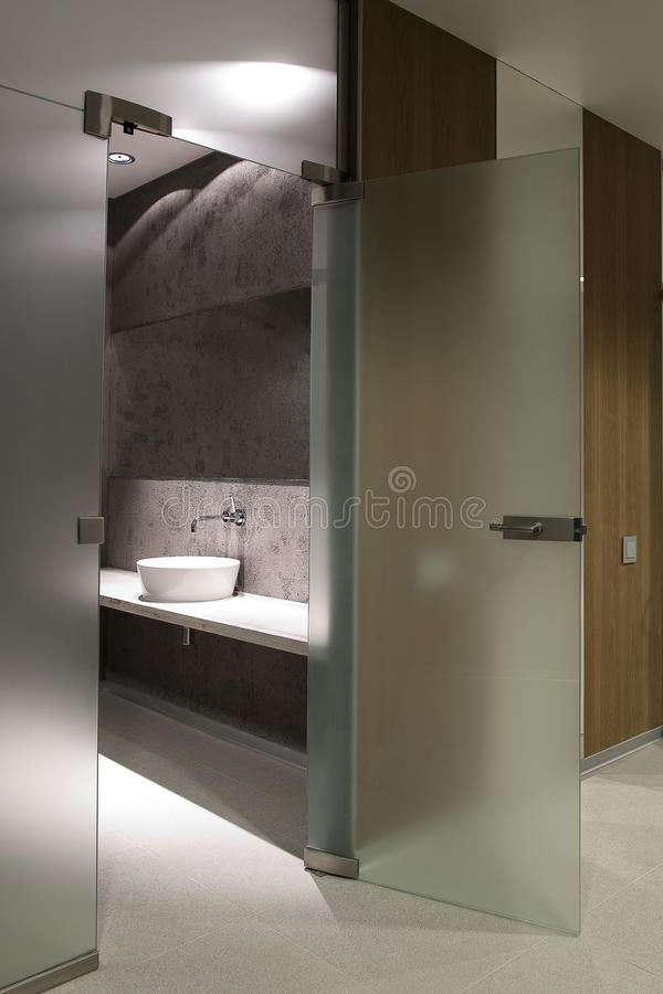 Toilet room. The modern interior of toilet room with glass doors royalty free stock photos