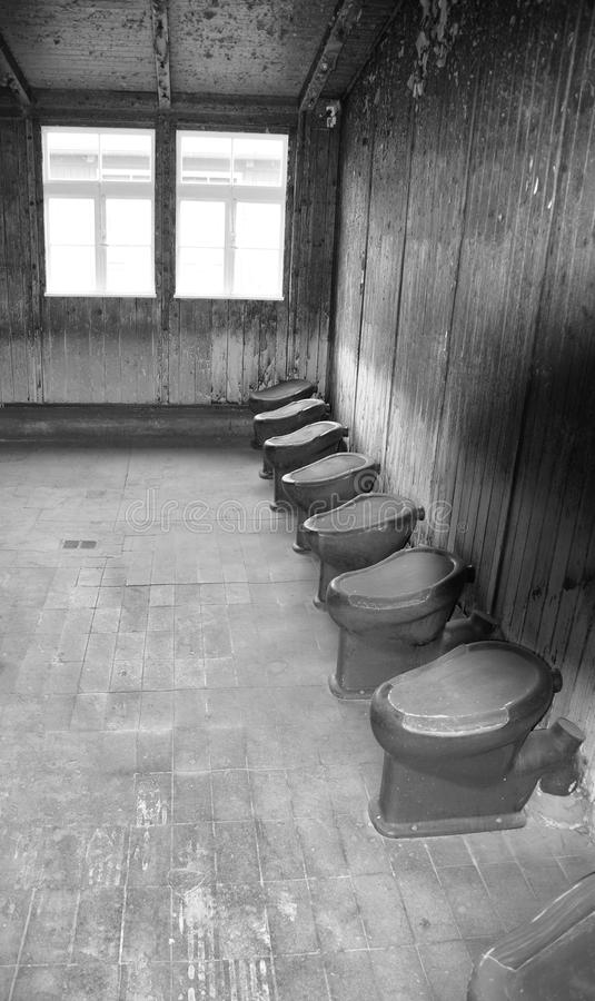 Toilet in the Sachsenhausen-Oranienburg. SACHSENHAUSEN-ORANIENBURG GERMANY MAY 24 2010: Toilet in the Sachsenhausen-Oranienburg was a Nazi concentration camp in royalty free stock photo