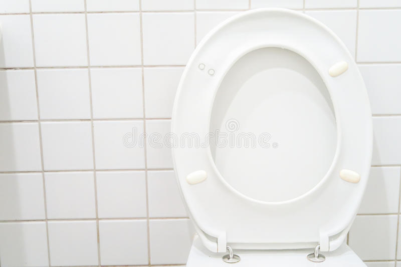 Toilet seat. Raised toilet seat with copy space to the left stock photography