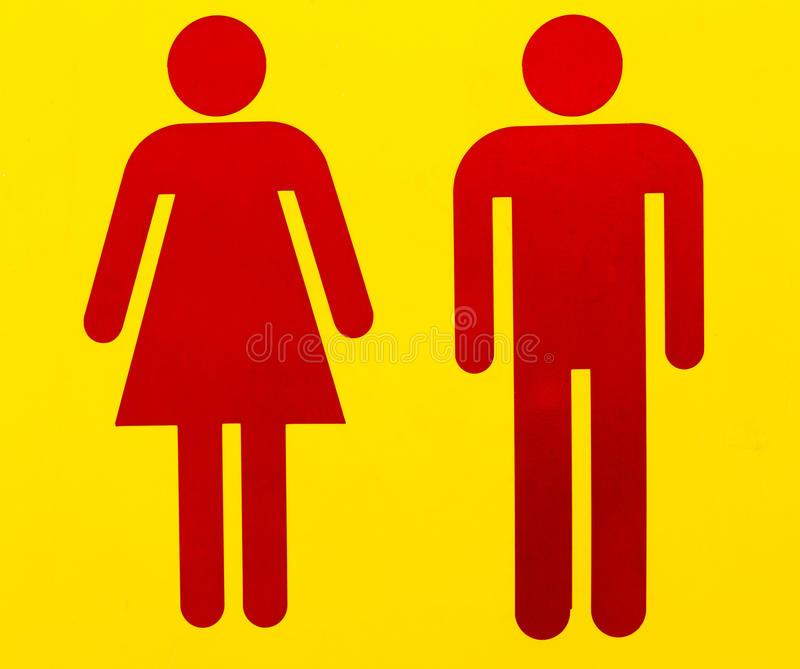Toilet sign. Male and female as often used to indicate restrooms with two silhouetted figures standing side by side on yellow royalty free stock image