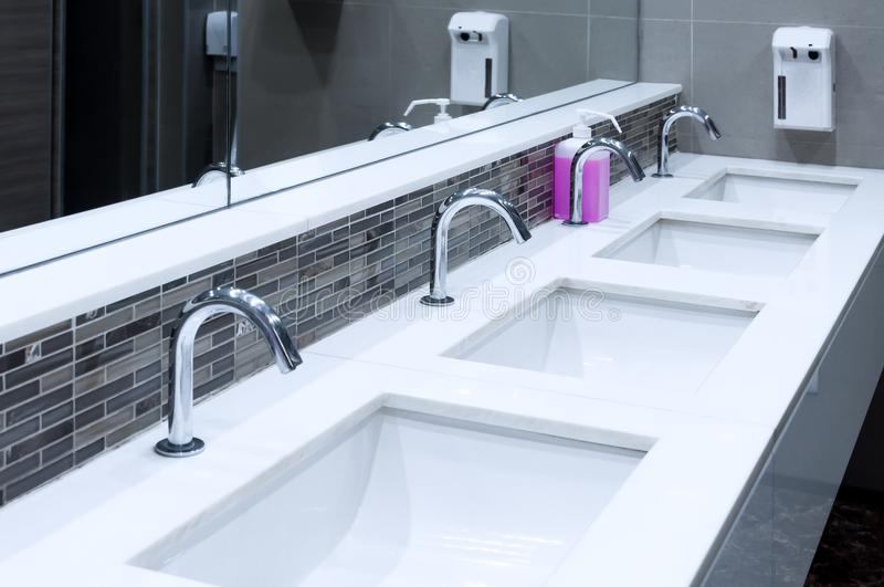 Toilet sink interior of public toilet with of washing hands royalty free stock photos