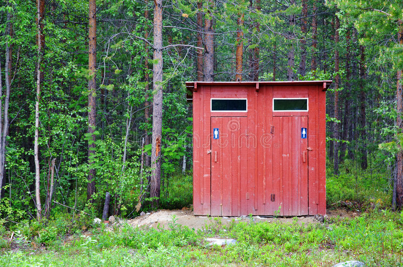 Toilet in a wood. Public toilet in a wood stock photo