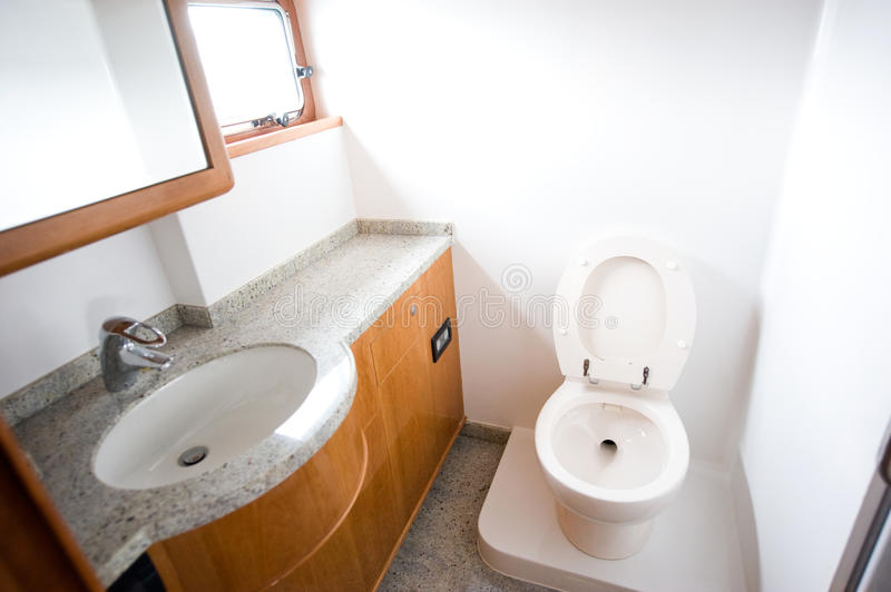 Toilet in yacht. A view of a toilet in yacht royalty free stock image