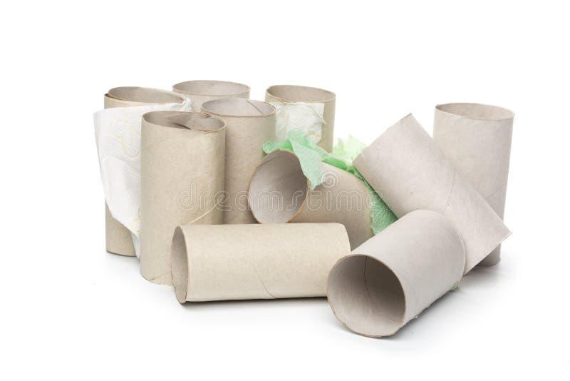 Toiletpapier op witte achtergrond stock foto's